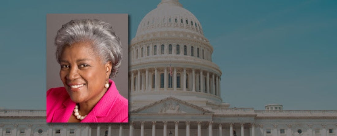 Headshot of Brazile in front of an image of the Capitol